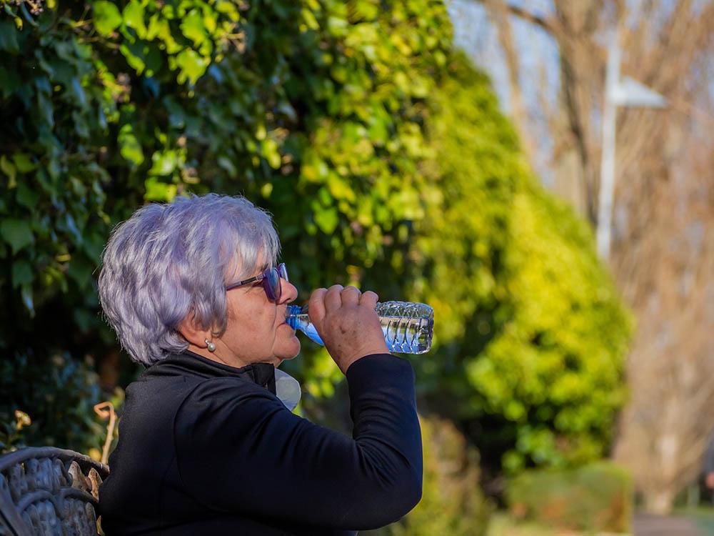 Woman drinking bottled water